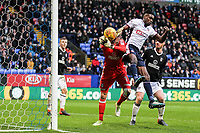 Bolton Wanderers' Sammy Ameobi competing with Fulham's goalkeeper Marcus Bettinelli<br /> <br /> Photographer Andrew Kearns/CameraSport<br /> <br /> The EFL Sky Bet Championship - Bolton Wanderers v Fulham - Saturday 10th February 2018 - Macron Stadium - Bolton<br /> <br /> World Copyright &copy; 2018 CameraSport. All rights reserved. 43 Linden Ave. Countesthorpe. Leicester. England. LE8 5PG - Tel: +44 (0) 116 277 4147 - admin@camerasport.com - www.camerasport.com