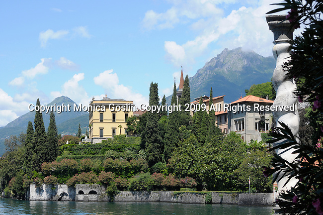 A view of  Varenna, a town on Lake Como, Italy from the Villa Monastero gardens with a column in the foreground.