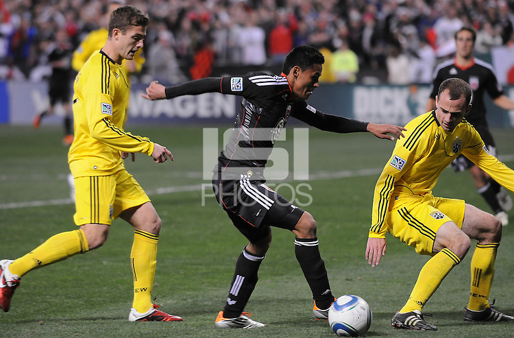 DC United midfielder Andy Najar (14) goes against Columbus Crew midfielder Robbie Rogers (18) left and defender Rich Balchan (2) right.   DC United defeated The Columbus Crew 3-1  at the home season opener, at RFK Stadium, Saturday March 19, 2011.