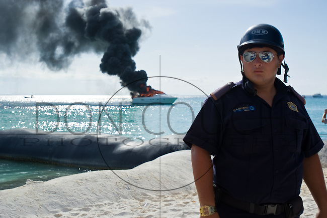 Boat fire off Playa Norte, Isla Mujeres, Mexico