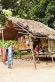 PHILIPPINES, Palawan, Barangay region, Batak family in their home in Kalakwasan Village