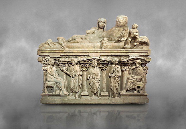"Roman relief sculpted sarcophagus of Aurelia Botiano and Demetria depicted reclining on the lid, 2nd century AD, Perge Inv 1.35.99. Antalya Archaeology Museum, Turkey.<br /> <br /> it is from the group of tombs classified as. ""Columned Sarcophagi of Asia Minor"". The lid of the sarcophagus is sculpted into the form of a ""Kline"" style Roman couch on which lie Julianus &  Philiska. This type of Sarcophagus is also known as a Sydemara Type of Tomb."