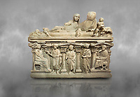 Roman relief sculpted sarcophagus of Aurelia Botiano and Demetria depicted reclining on the lid, 2nd century AD, Perge Inv 1.35.99. Antalya Archaeology Museum, Turkey.<br /> <br /> it is from the group of tombs classified as. &quot;Columned Sarcophagi of Asia Minor&rdquo;. The lid of the sarcophagus is sculpted into the form of a &ldquo;Kline&rdquo; style Roman couch on which lie Julianus &amp;  Philiska. This type of Sarcophagus is also known as a Sydemara Type of Tomb.