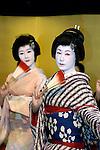 Geisha perform a dance for customers at a geisha house in Tokyo, Japan.