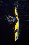 Sea kayaker Nigel Foster practices a low brace turn, viewed from above, single sea kayak type: Legend,