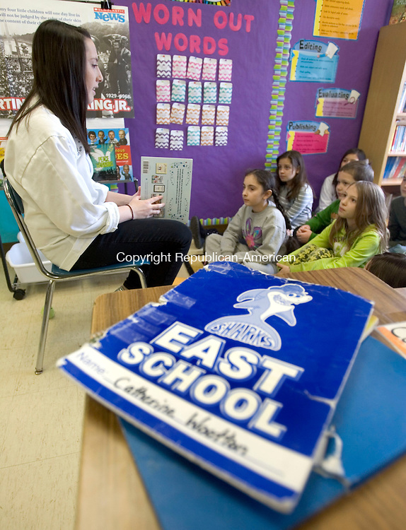 TORRINGTON CT. 27 February 2014-022714SV01-Ama Vermette, 17 of Torrington reads to a 4th grade class at East School in Torrington Thursday. Oliver Wolcott Technical High School students, that formally went to East School, spent the morning reading a book to the classes about good character traits. <br /> Steven Valenti Republican-American