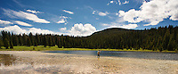 An angler fishes for brook trout at a mountain lake in Yellowstone National Park.