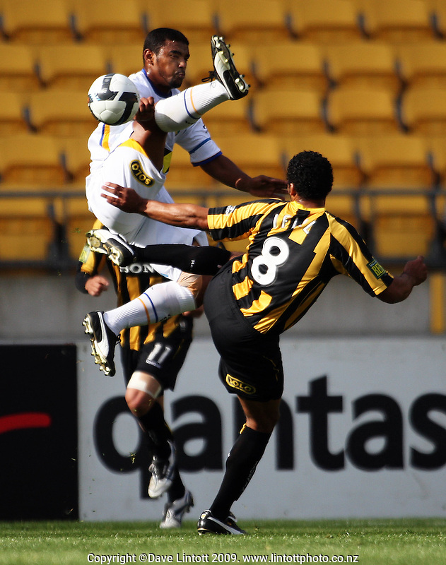 Gold Coast's Robson beats Paul Ifil to the ball during the A-League football match between Wellington Phoenix and Gold Coast United at Westpac Stadium, Wellington, New Zealand on Sunday, 25 October 2009. Photo: Dave Lintott / lintottphoto.co.nz.