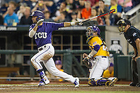 TCU Horned Frogs outfielder Dane Steinhagen (10) follows through on his swing against the LSU Tigers in Game 10 of the NCAA College World Series on June 18, 2015 at TD Ameritrade Park in Omaha, Nebraska. TCU defeated the Tigers 8-4, eliminating LSU from the tournament. (Andrew Woolley/Four Seam Images)