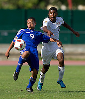 Kellyn Perry-Acosta (3) of the United States has the ball cleared away form him by Dairon Perez (9) of Cuba during the first day of the group stage at the CONCACAF Men's Under 17 Championship at Catherine Hall Stadium in Montego Bay, Jamaica. The United States defeated Cuba, 3-1.