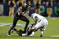 1 September 2011:  FIU linebacker Winston Fraser (34) and defensive back Chuck Grace (21) combine to tackle North Texas running back James Hamilton (2) in the first half as the FIU Golden Panthers defeated the University of North Texas, 41-16, at FIU Stadium in Miami, Florida.