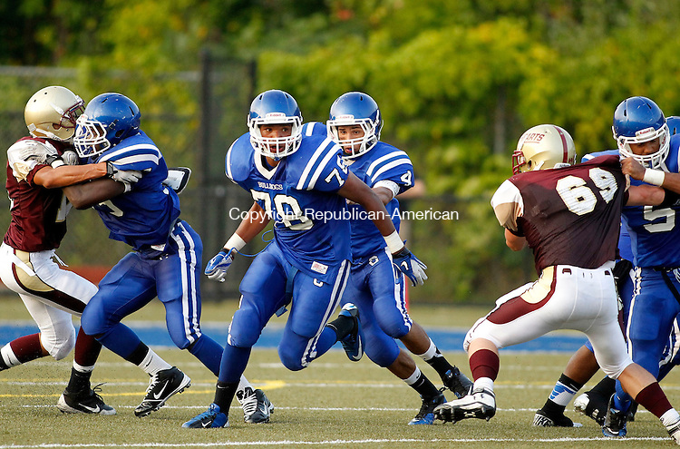 Waterbury, CT-07 September 2012-090712CM08- Crosby's Adrian Flemming clears the way for quarterback Mike Reyes during the first quarter during the City Jamboree Friday night at Municipal Stadium in Waterbury.  Sacred Heart won the quarter.     Christopher Massa Republican-American