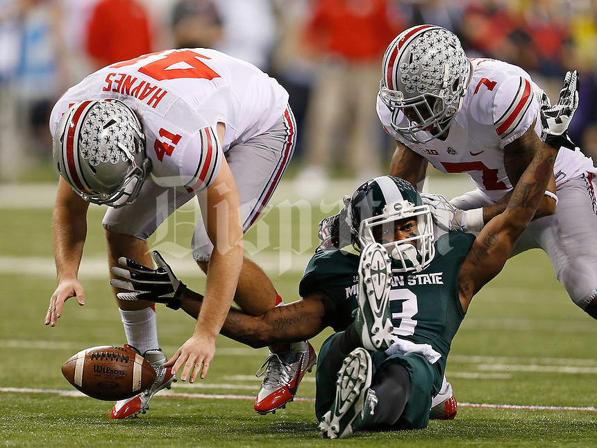 Michigan State Spartans wide receiver Macgarrett Kings Jr. (3) looks for the flag after being interfered with on a punt return by Ohio State Buckeyes long snapper Bryce Haynes (41) and Ohio State Buckeyes running back Jordan Hall (7) during the first half of the Big Ten Championship football game at Lucas Oil Stadium in Indianapolis on Friday, December 7, 2013. (Columbus Dispatch photo by Jonathan Quilter)