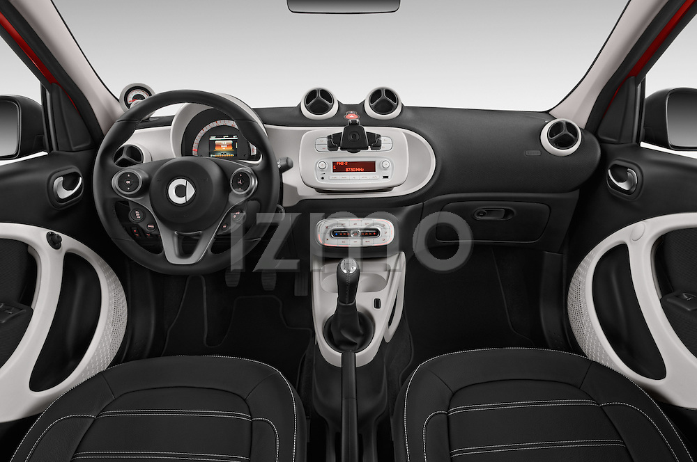 Stock photo of straight dashboard view of a 2015 Smart FORFOUR Prime 5 Door Micro Car Dashboard