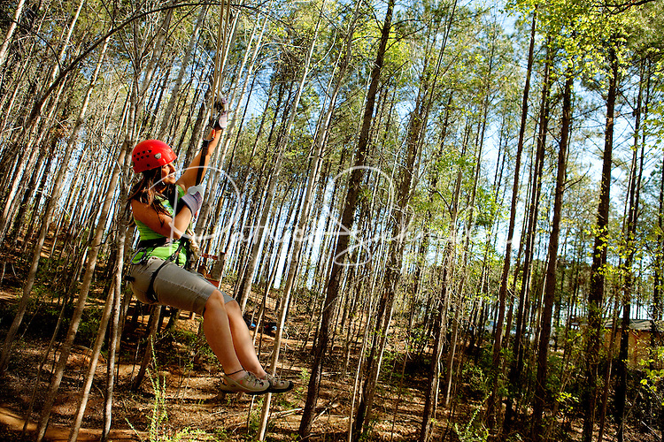 Outdoor enthusiasts work their muscles at the US National Whitewater Center's new Canopy Tour, a guided above-the-ground tour that opened in April 2011. Participants explore the woodlands along the Catawba River.