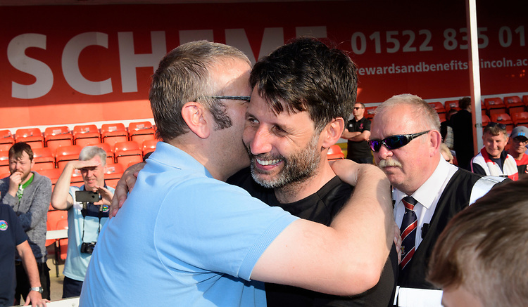 Lincoln City manager Danny Cowley receives a hug from a fan as they celebrate winning the league<br /> <br /> Photographer Chris Vaughan/CameraSport<br /> <br /> The EFL Sky Bet League Two - Lincoln City v Tranmere Rovers - Monday 22nd April 2019 - Sincil Bank - Lincoln<br /> <br /> World Copyright © 2019 CameraSport. All rights reserved. 43 Linden Ave. Countesthorpe. Leicester. England. LE8 5PG - Tel: +44 (0) 116 277 4147 - admin@camerasport.com - www.camerasport.com