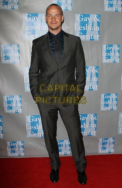 "PETER PAIGE .L.A. Gay & Lesbian Center's ""An Evening With Women"" held at The Beverly Hilton Hotel, Beverly Hills, California, USA..April 16th, 2011.full length grey gray suit hands in pockets .CAP/ADM/KB.©Kevan Brooks/AdMedia/Capital Pictures."