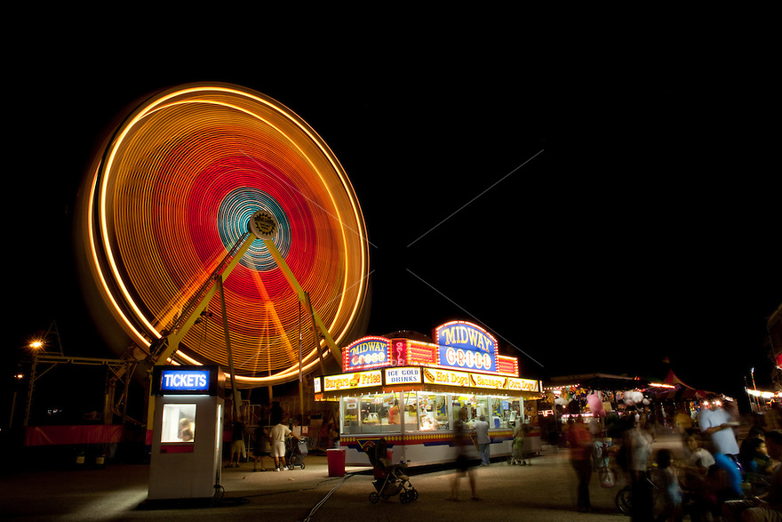 Revolving Ferris wheel and midway, night (long exposure), austin, texas