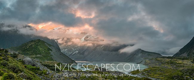 Moody sunrise with Mueller Lake and Mount Sefton emerging from clouds, Aoraki Mount Cook National Park, UNESCO World Heritage Area, Mackenzie Country, South Island, New Zealand, NZ