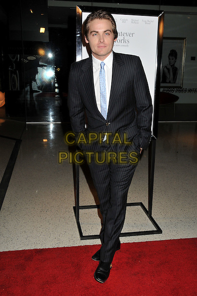 "KEVIN ZEGERS .""Whatever Works"" Los Angeles Premiere held at the Pacific Design Center, West Hollywood, CA, USA..June 8th, 2009.full length black suit blue tie hands in pockets .CAP/ADM/BP.©Byron Purvis/AdMedia/Capital Pictures."