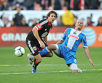Dejan Jakovic (7) of D.C. United gets fouled by Conor Casey  (6) of the Philadelphia Union. The Philadelphia Union defeated D.C. United 3-2, at RFK Stadium, Sunday April 21, 2013.