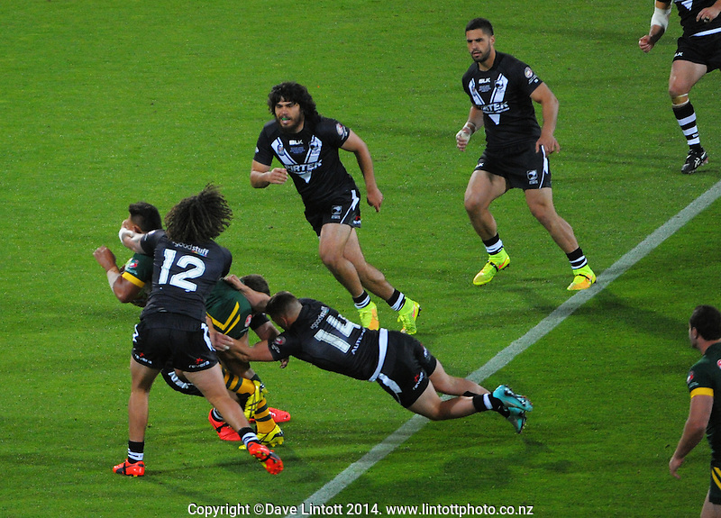 Kevin Proctor stops Josh Papali'i during the Four Nations rugby league final between the NZ Kiwis and Australia Kangaroos at Westpac Stadium, Wellington on Saturday, 15 November 2014. Photo: Dave Lintott / lintottphoto.co.nz