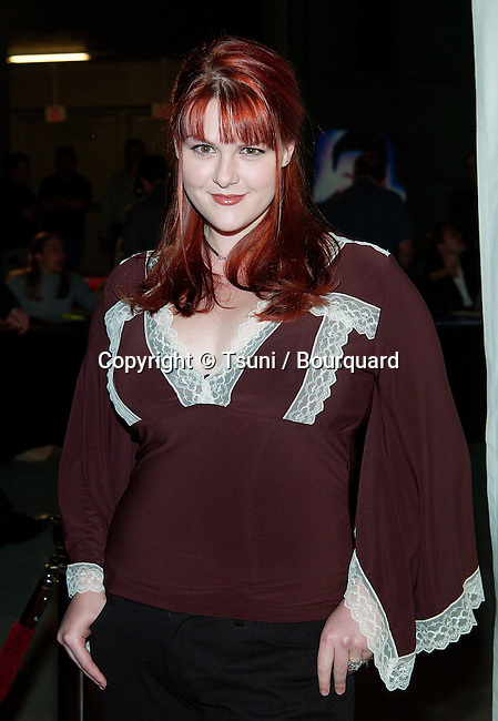 Sara Rue arriving at the Hollywood Film Festival's Opening Night: The Ring premiere at the ArcLight Theatre in Los Angeles. October 2, 2002.          -            RueSara68.jpg