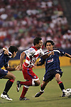24 July 2007:  Arturo Alvarez (12) of FC Dallas pushes the ball through two opposing defenders from CD Guadalajara.  FC Dallas tied Chivas de Guadalajara 1-1 at Pizza Hut Park in Frisco, Texas, in the opening match of SuperLiga 2007.