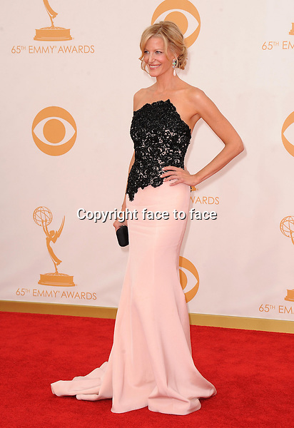 Anna Gunn arrives at the 65th Primetime Emmy Awards at Nokia Theatre on Sunday Sept. 22, 2013, in Los Angeles.<br />