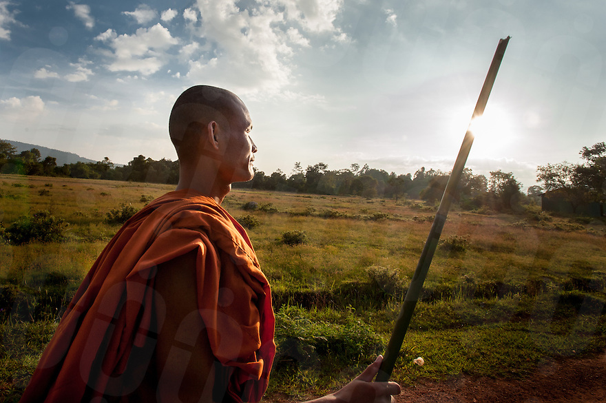 November 03, 2013 - Koh Kong, Cambodia. A Buddhist monk begins his 25km trek out of Cambodia's remote Areng Valley after a multi-day environmental protest. Part of a larger story on the recent trend of Buddhist monks entering the political sphere in Cambodia. © Luc Forsyth / Ruom