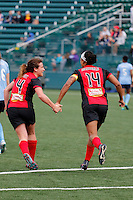 Rochester, NY - Saturday May 21, 2016: Western New York Flash midfielder Elizabeth Eddy (4) and Western New York Flash forward Jessica McDonald (14) celebrate a goal. The Western New York Flash defeated Sky Blue FC 5-2 during a regular season National Women's Soccer League (NWSL) match at Sahlen's Stadium.