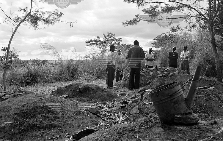 The funeral of an AIDS victim in a small village outside Lilongwe, Malawi on March 9, 2001. Many adults in the village have died of the disease, orphaning their children. More than 13 million African children have been orphaned by the AIDS pandemic. Worldwide, more than 20 million people have died since 1981.