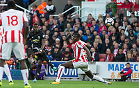 Paul Pogba of Man Utd hits a shot past Kurt Zouma of Stoke City during the Premier League match between Stoke City and Manchester United at the Britannia Stadium, Stoke-on-Trent, England on 9 September 2017. Photo by Andy Rowland.