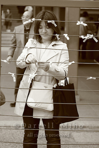 Mar 6, 2006; Tokyo, JPN; Asakusa.Visitors tie their mikuji (written fortunes) to a wire for the gods blessing at the Senso-ji temple...Photo credit:  Darrell Miho
