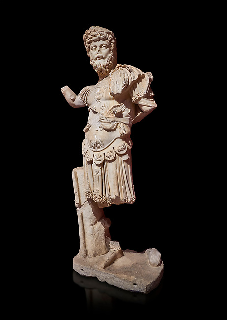 Roman statue of Emperor Septimus Severus. Marble. Perge. 2nd century AD. Inv no 3266 . Antalya Archaeology Museum; Turkey. Against a black background.