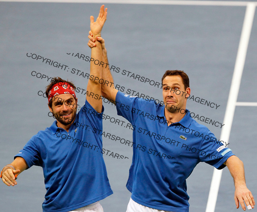 French Davis Cup players Michael Llodra (L) and Arnaud Clement (R) celebrate victory in their dubles match against Nenad Zimonjic and Viktor Troicki of Serbia. France leads 2:1 with only two matches remaining on Sunday. Davis Cup finals, Serbia vs France in Belgrade Arena in Belgrade, Serbia, Saturday, 4. December 2010. (credit & photo: Srdjan Stevanovic/Starsportphoto.com©)
