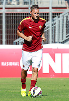 "Calcio, amichevole Roma vs Under 23 Indonesia. Rieti, stadio ""Manlio Scopigno"", 18 luglio 2014. <br /> AS Roma forward Francesco Totti warms up prior to the start of the friendly football match between AS Roma and Under 23 Indonesia at ""Manlio Scopigno"" stadium in Rieti, Italy, 18 July 2014.<br /> UPDATE IMAGES PRESS/Isabella Bonotto"