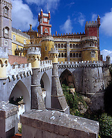 A view of the ramparts and cluster of castellated turrets and towers of the Palacio de Pena, Sintra