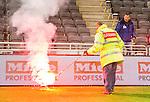 Stockholm 2015-05-25 Fotboll Allsvenskan Djurg&aring;rdens IF - AIK :  <br /> Personal i Tele2 Arena plockar upp en bengal fr&aring;n planen efter att AIK:s supportrar sl&auml;ngt ut den under ett br&aring;k efter matchen mellan Djurg&aring;rdens IF och AIK <br /> (Foto: Kenta J&ouml;nsson) Nyckelord:  Fotboll Allsvenskan Djurg&aring;rden DIF Tele2 Arena AIK Gnaget supporter fans publik supporters bengal bengaler