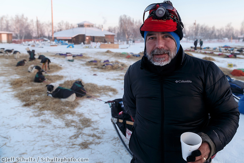Scott Janssen warming up with some coffee at the Huslia checkpoint on the morning of Sunday  March 15, 2015 during Iditarod 2015.  <br /> <br /> (C) Jeff Schultz/SchultzPhoto.com - ALL RIGHTS RESERVED<br />  DUPLICATION  PROHIBITED  WITHOUT  PERMISSION