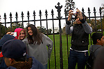 Mikayla Dubie, 13, from left, Lourdes Leguiza, 13, and Wiomary Parrilla, 14, take photos of themselves in front of the White House during their eighth-grade field trip  Wednesday, Nov. 7, 2012 in Washington, D.C. The students from Port Chester Middle School in Port Chester, NY, held a mock election on election day where they said Pres. Obama was the overwhelming winner, according to their English Language Arts teacher, Brenda Burke.