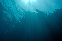 Rays of sunlight shining into water, Mediterranean Sea, France
