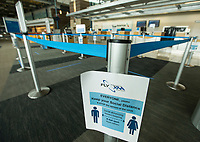 A sign asks passengers to maintain social distancing Wednesday, May 13, 2020, in the check-in area at Northwest Arkansas National Airport in Highfill. Go to nwaonline.com/200517Daily/ to see more photos.<br /> (NWA Democrat-Gazette/Ben Goff)