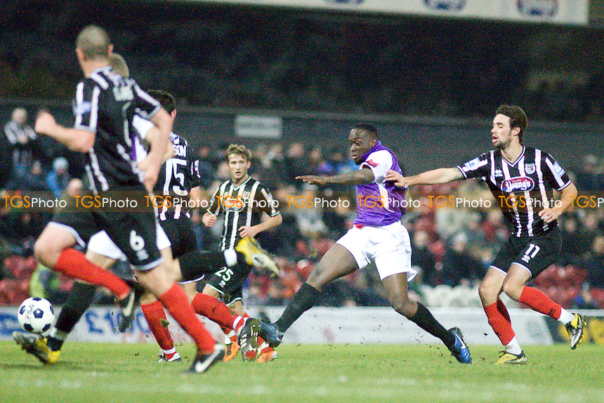 Leslie Thompson strikes on goal for AFC Hornchurch.- Grimsby Town vs AFC Hornchurch - FA Trophy 2nd Round Football at Blundell Park - 14/01/12 - MANDATORY CREDIT: Mark Hodsman/TGSPHOTO - Self billing applies where appropriate - 0845 094 6026 - contact@tgsphoto.co.uk - NO UNPAID USE.