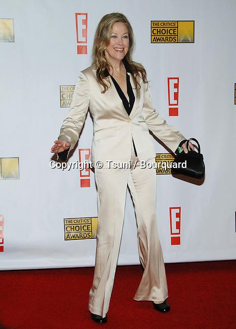 Catherine O'Hara arriving at the 12th Annual  Critics Choice Awards ( from the Broadcast Film Association ) at the Santa Monica Civic Auditorium in Los Angeles. January 12, 2007.<br /> <br /> full length<br /> cream suit
