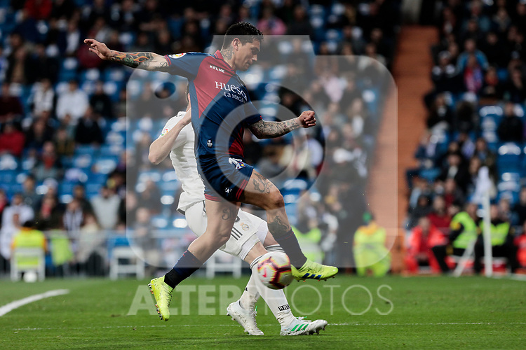 Real Madrid's Nacho Fernandez and SD Huesca's Luis Ezequiel 'Chimy' Avila during La Liga match between Real Madrid and SD Huesca at Santiago Bernabeu Stadium in Madrid, Spain.March 31, 2019. (ALTERPHOTOS/A. Perez Meca)