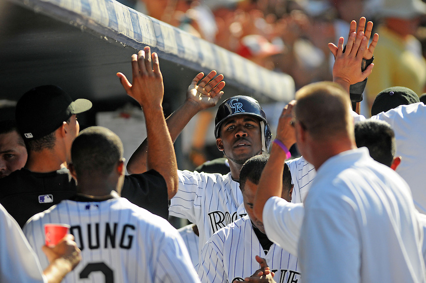 25 AUGUST 2010: Colorado Rockies center fielder Dexter Fowler (24) celebrates a run in the dugout during a regular season Major League Baseball game between the Colorado Rockies and the Atlanta Braves at Coors Field in Denver, Colorado. The Rockies won 12-10 after being down 10-1 in the 3rd inning.   *****For Editorial Use Only*****