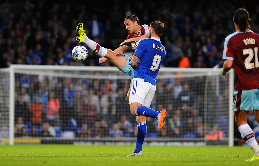 Burnley's Michael Duff gets to the ball before Ipswich Town's Daryl Murphy<br /> <br /> Photographer Ashley Pickering/CameraSport<br /> <br /> Football - The Football League Sky Bet Championship - Ipswich Town v Burnley - Tuesday 18th August 2015 - Portman Road - Ipswich<br /> <br /> &copy; CameraSport - 43 Linden Ave. Countesthorpe. Leicester. England. LE8 5PG - Tel: +44 (0) 116 277 4147 - admin@camerasport.com - www.camerasport.com