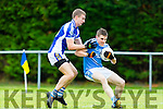 Templenoe Brian Crowley tackles Pat Brown during the Junior SF in Beaufort on Sunday