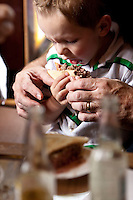 3 year-old Emerson Bennett eats a hamburger at Louis' Lunch in New Haven, CT, USA, 26 May 2009.